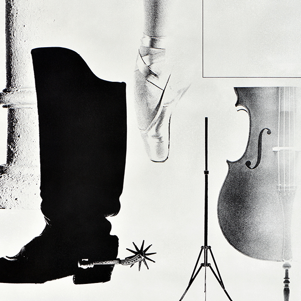 black and white image including boots, ballet shoes, and a cello