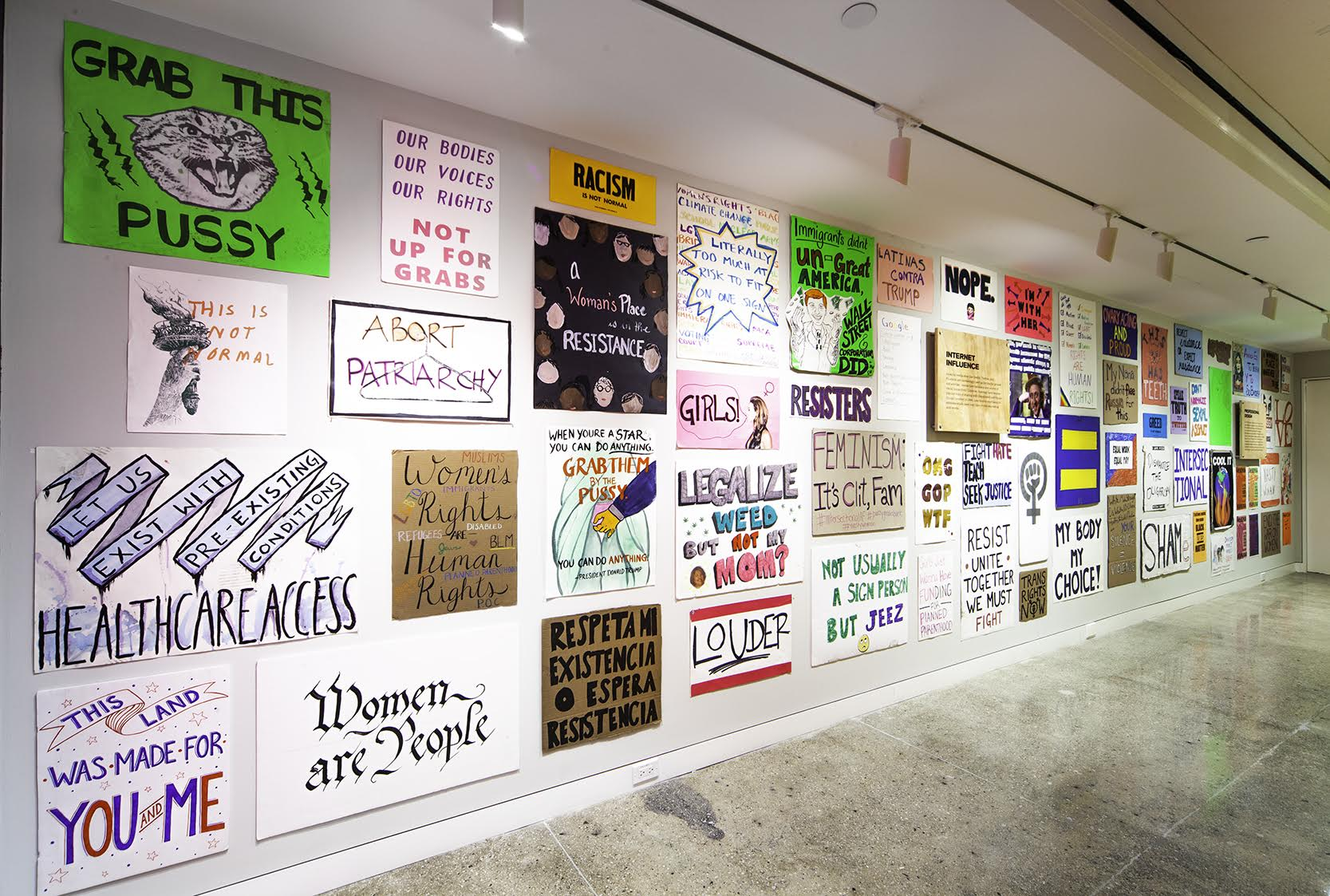 photograph of a poster wall from the Women's March exhibition