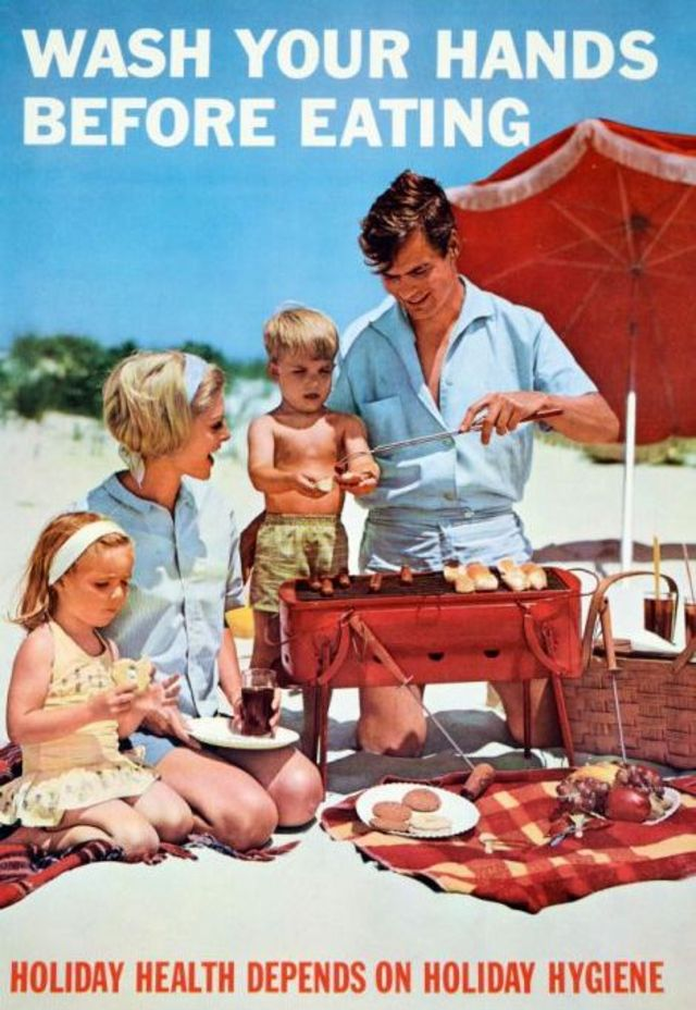 poster with a photograph of a family at the beach cooking over a small grill