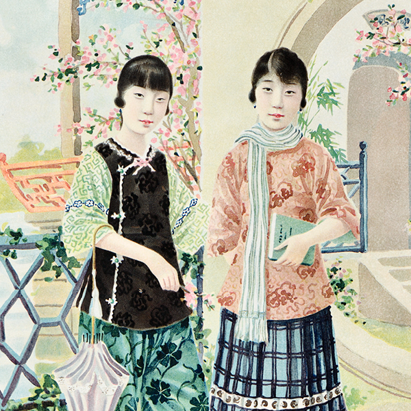 two young women heavily accessorized holding school books