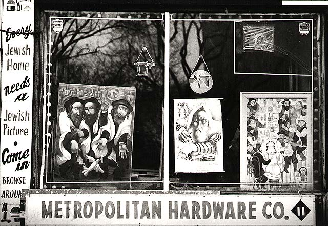 photograph of a gallery storefront window featuring jewish-themed art