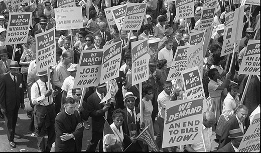 photograph of people carrying protest signs