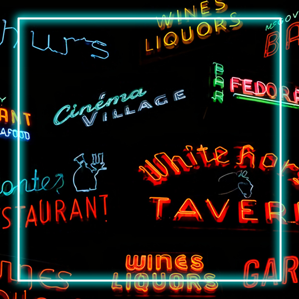 Different red and blue neon signs on a black background with a neon blue frame